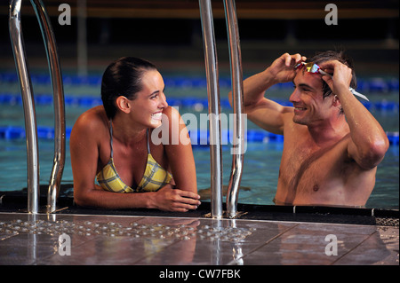 young couple in swimming pool - Stock Photo