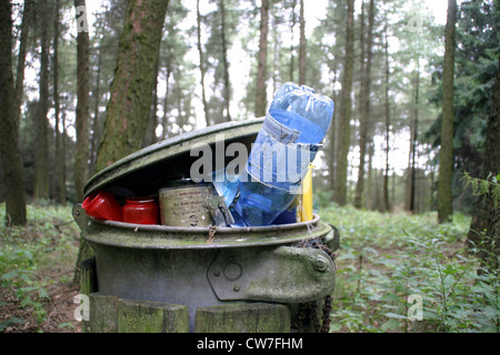 Garbage can in the forest - Stock Photo