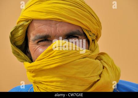berber with traditional tagelmust, portrait, Morocco, Erg Chebbi, Sahara - Stock Photo