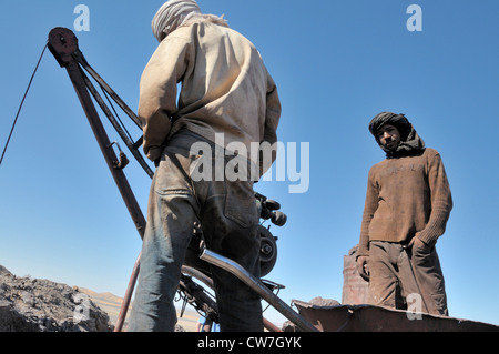two miners with tagelmusts, mining of lead sulfide , Morocco, Erg Chebbi - Stock Photo