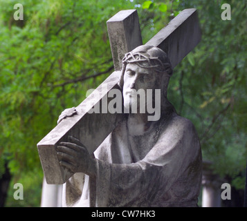 Statue on a cemetery - Stock Photo
