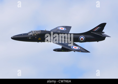 Hawker Hunter T7aircraft in the markings of 111 Squadron, RAF, making a fast flypast at RAF Fairford - Stock Photo