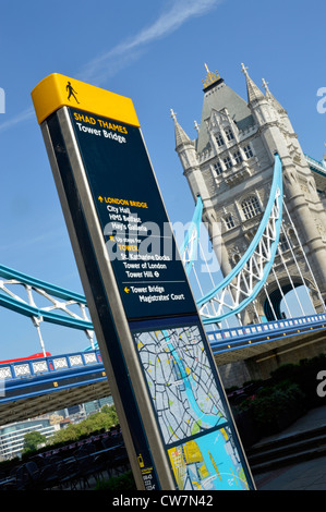 Legible streets sign and local map on south side of River Thames  in Southwark beside Tower Bridge London England - Stock Photo