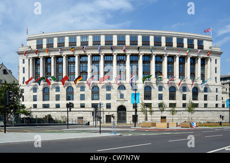 Unilever House headquarters building with international flags Blackfriars City of London England UK - Stock Photo