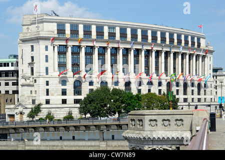 Unilever House headquarters building with international flags seen from Blackfriars Bridge City of London England - Stock Photo