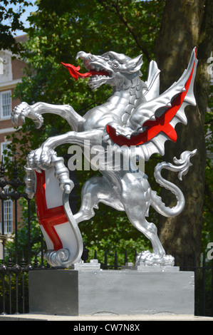Dragon and shield statue marking the boundary of the City of London - Stock Photo