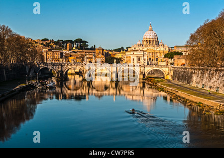 View of the Ponte Vittorio Emanuele II bridge over the Timber river with St Peters in the background - Stock Photo