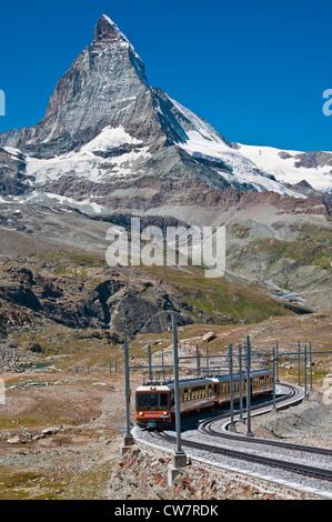 A train of the Gornergratbahn rack railway with Matterhorn behind, Zermatt, Wallis, Switzerland - Stock Photo