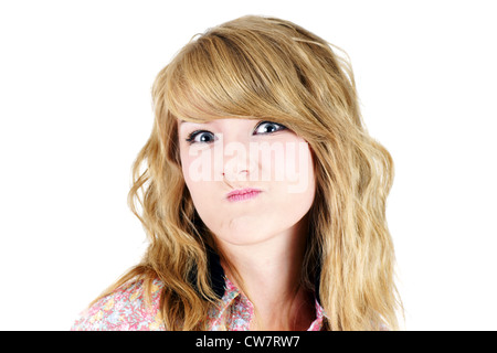 Cute young blond teenager girl making a funny unhappy or upset face, studio shot on white. - Stock Photo