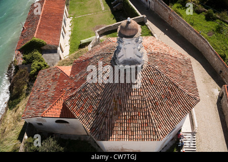 the red tiled roof of a church in Piran Slovenia - Stock Photo