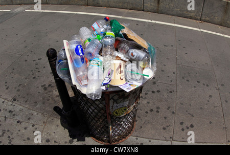 Overflowing trash receptacle New York City - Stock Photo