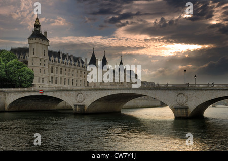 The Pont au Change, bridge over the Seine River and the Conciergerieis, a former royal palace and prison in Paris, - Stock Photo