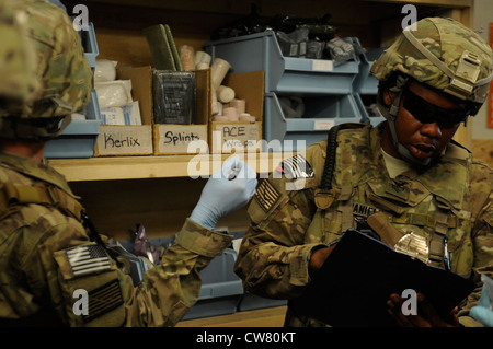 U.S. Navy Hospital Corpsman 1st Class Carlston Daniels, Kandahar Provincial Reconstruction Team, treats a simulated - Stock Photo