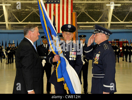 Secretary if the Air Force Michael Donley passes the Chief of Staff guidon to Gen. Mark A. Welsh III during a ceremony - Stock Photo