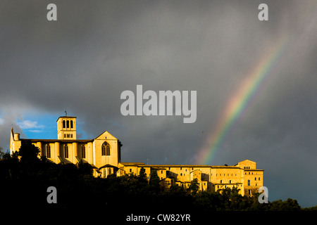 Rainbow over the Monastery of St. Francis of Assisi, Assisi, Umbria, Italy, Europe - Stock Photo