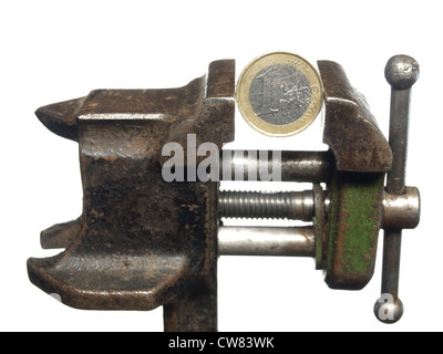 Shabby coin in one euro is clamped in the old vice, isolated on a white background - Stock Photo