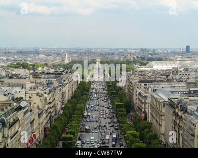 A view of the Louvre and looking down the Champs Elysees from the top of the Arc de Triomph - Stock Photo