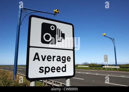 average speed road safety overhead traffic cameras and warning sign scotland uk united kingdom - Stock Photo