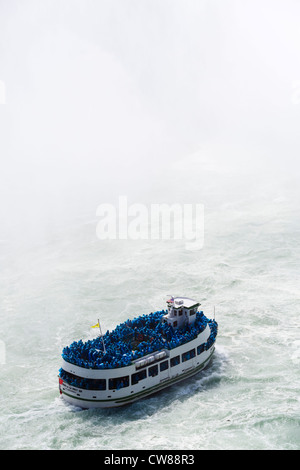 Maid of the Mist tour boat in front of the Horseshoe Falls viewed from the Canadian side, Niagara Falls , Ontario, - Stock Photo