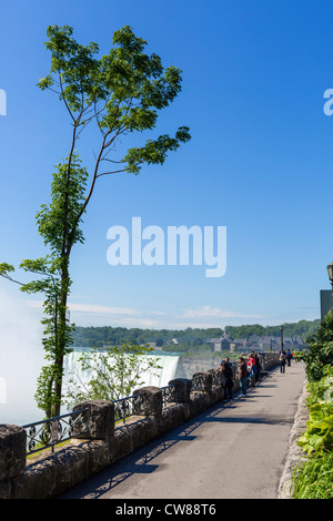 Tourists on the path to the Horseshoe Falls on the Canadian side, Niagara Falls , Ontario, Canada - Stock Photo