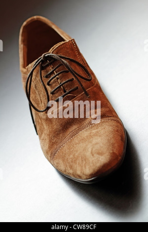 Brown mens suede shoe close-up. Vertical composition. - Stock Photo