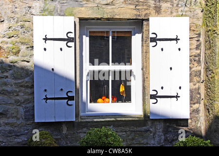 Old, white shutters with a small window - Stock Photo