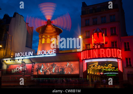 Moulin Rouge, French for Red Mill, is a cabaret in the Pigalle area of Paris, France - Stock Photo