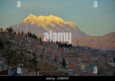 La Paz, highest capital city in the world at 3700m. Bolivia, South America. Snow capped mountain at sunset. - Stock Photo
