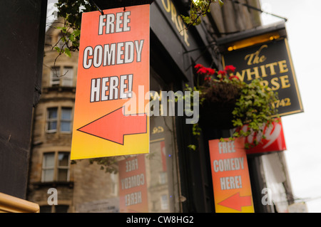 Signs advertising free comedy events outside the White Horse pub in Edinburgh - Stock Photo