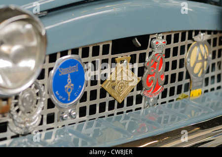 Old car badges on a vintage car, including an Automobile Association badge - Stock Photo