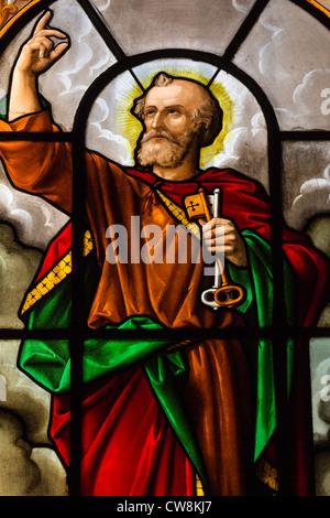 Stained glass window depicting  Saint Peter holding key to heaven in Église Sainte-Élisabeth-de-Hongrie, Paris,France - Stock Photo