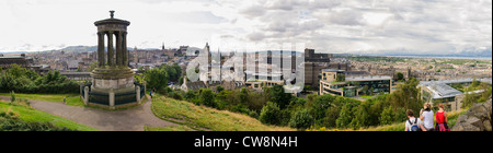 Panoramic view over Edinburgh from the hill at Regent Gardens, with the Dugald Stewart Monument in the foreground. - Stock Photo