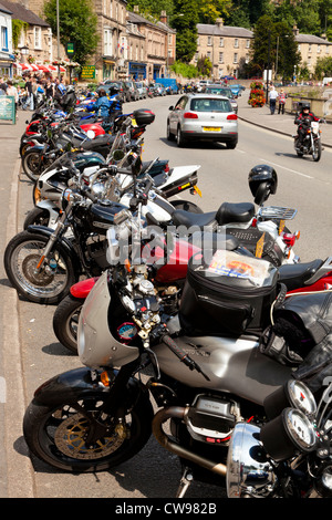 Line of motorcycles parked along the A6 road during Summer, Matlock Bath, Derbyshire, England, UK - Stock Photo