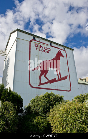 The Dingo Flour sign on the side of the Great Southern Roller Flour Mills in Fremantle, Western Australia. - Stock Photo