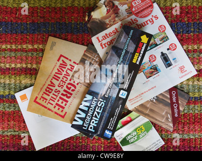 Junk mail sitting on a doormat in Britain - Stock Photo