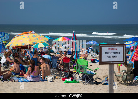Truro, Massachusetts - A sign warns of recent shark sightings at Head of the Meadow Beach in Cape Cod National Seashore. - Stock Photo