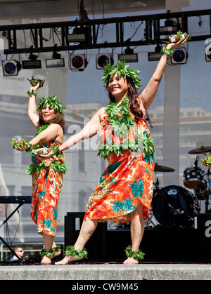 Hiawiaian Pacific Dancer performing at Yonge and Dundas Square in downtown Toronto;Ontario;Canada - Stock Photo