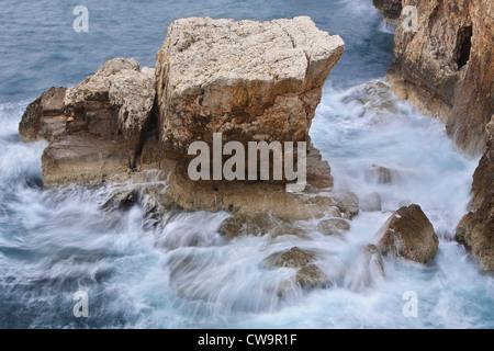 Waves breaking on a solid rock, Cape Kamenjak, Istria, Croatia - Stock Photo