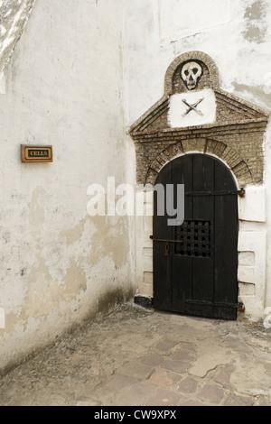 Entrance to slave cells in Castle of St. George (Elmina Castle), Elmina, Ghana - Stock Photo