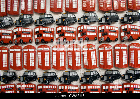 London tourist fridge magnets display showing telephone boxes black taxis and buses - Stock Photo