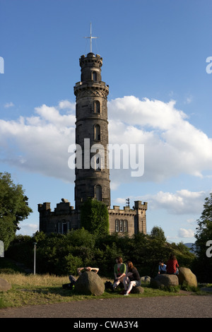 visitors in front of nelson monument on calton hill edinburgh scotland uk united kingdom - Stock Photo