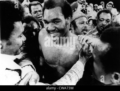 GEORGE FOREMAN- The boxer is congratulated in the ring after defeating Joe Frazier for the world heavyweight championship. - Stock Photo