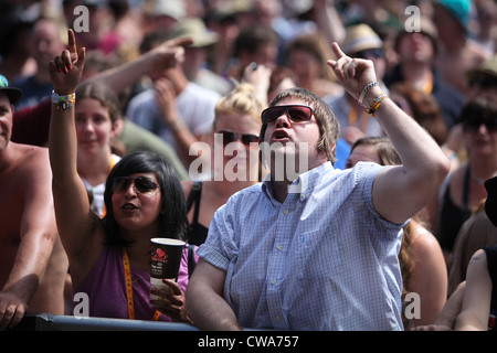 The crowd enjoying the live music at the V Festival in Hylands Park, Chelmsford, Essex - Stock Photo