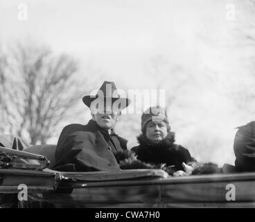 Woodrow Wilson (1856-1924) and his second wife, Edith Bolling Galt Wilson riding in an open carriage in Washington, - Stock Photo
