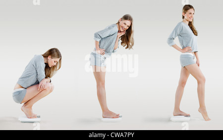 Young woman on weighing scales, composite - Stock Photo
