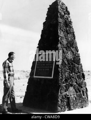 A man reading the plaque on a monument at The Trinity Site, where the first atomic explosion took place, Socorro, - Stock Photo