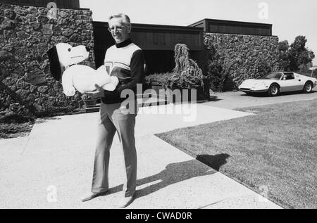 Charles M. Schulz, (1922-2000), American cartoonist and creator of the comic strip 'Peanuts', holding a Snoopy doll, - Stock Photo