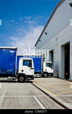 Truck parked outside distribution warehouse - Stock Photo