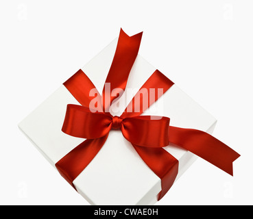 Gift box with red ribbon - Stock Photo