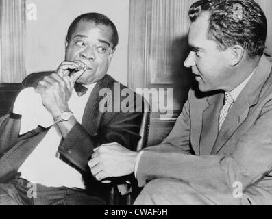 Louis Armstrong  (1901-1971) holding horn mouthpiece, demonstrating how to 'make the horn cry' for Vice President Richard Stock Photo